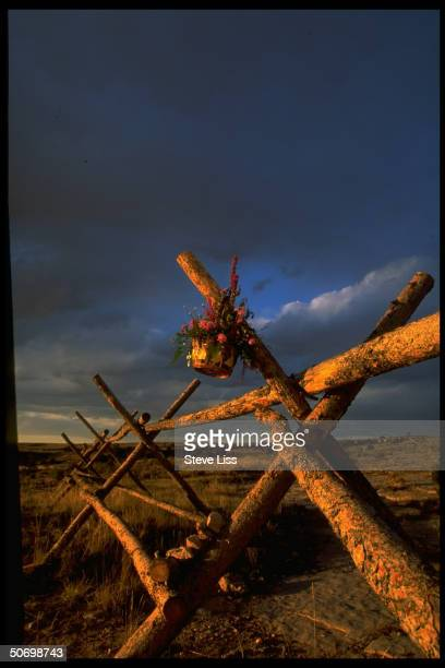 Basket of flowers hangs from fence where Matthew Shepard an openly gay Univ of Wyoming student was tied beaten in savage assault by alleged...