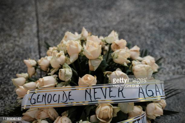A basket of flowers is offered on the mass grave as Rwanda marks the 25th Commemoration of the 1994 Genocide at the Kigali Genocide Memorial in...