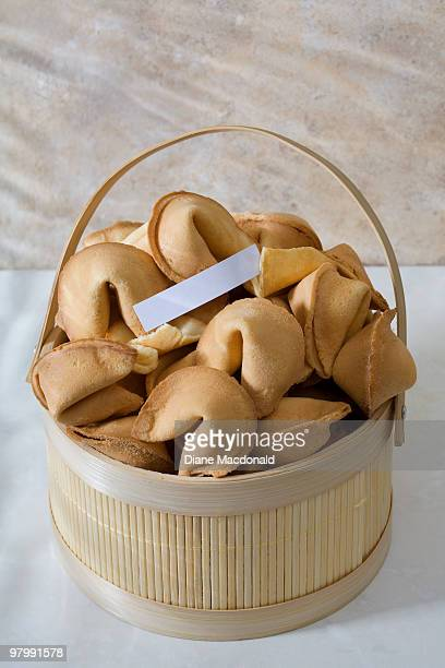 A basket of fortune cookies and a blank fortune