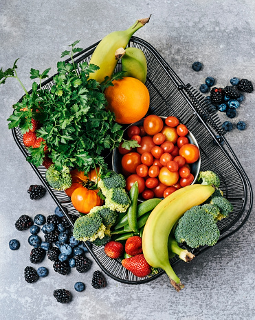 A basket of fresh vegetables, and fruits - gettyimageskorea