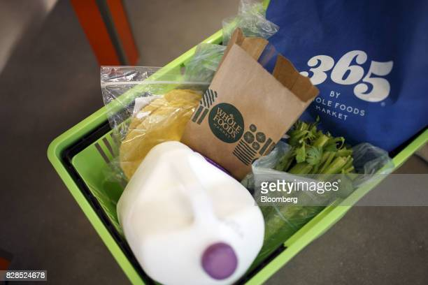 A basket of groceries is seen during the grand opening of a Whole Foods Market 365 location in Santa Monica California US on Wednesday Aug 9 2017 The...