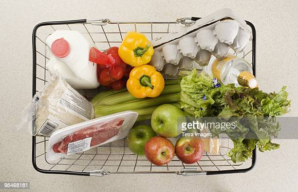 basket of groceries - food staple stock pictures, royalty-free photos & images