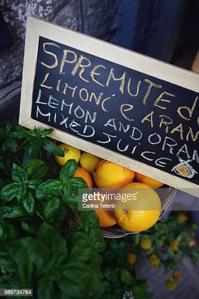 Basket of oranges and fresh basil