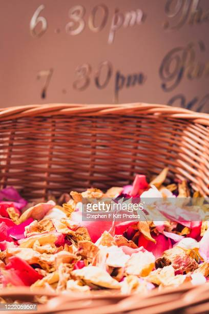 basket of petals - confetti stock pictures, royalty-free photos & images