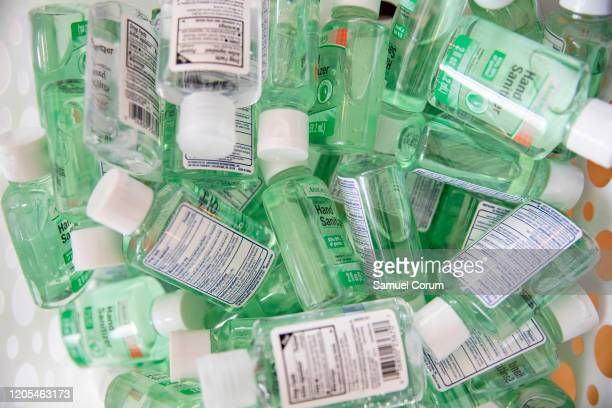 A basket of smaller bottles of hand sanitizer in the coronavirus popup store by Adilisha Patrom owner of the Suites DC a coworking and event space...