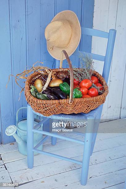 basket of vegetables and herbs - straw hat stock pictures, royalty-free photos & images