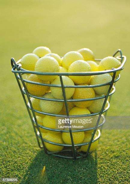 Basket of yellow golf balls