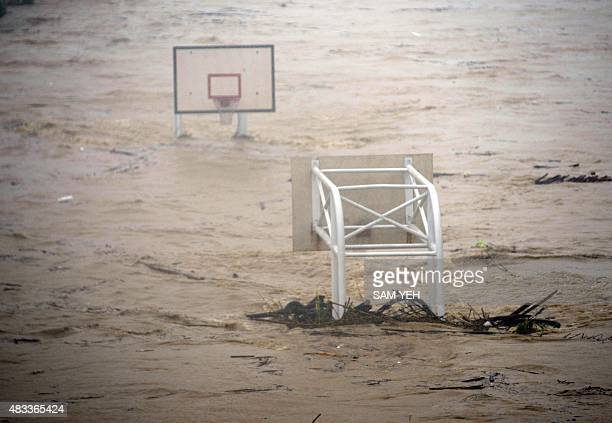 A basket stadium is flooded by the Jingmei river as typhoon Soudelor hits Taipei on August 8 2015 Typhoon Soudelor battered Taiwan with fierce winds...