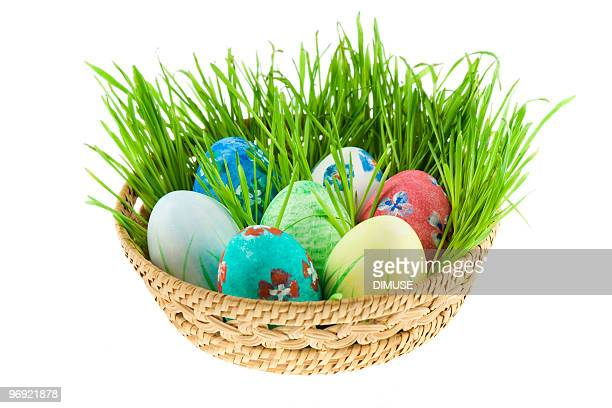 basket with easter eggs - easter basket stock pictures, royalty-free photos & images