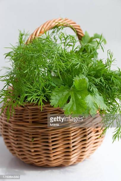 basket with herbs - lutavia stock pictures, royalty-free photos & images