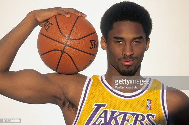 Closeup portrait of Los Angeles Lakers Kobe Bryant posing with ball on shoulder and flexing bicep during photo shoot Los Angeles CA CREDIT Walter...