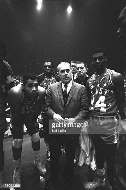 15th NBA AllStar Game Team East head coach Red Auerbach talks to Sam Jones Oscar Robertson and their teammates on sidelines during game vs Team West...