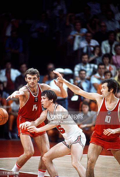 1972 Summer Olympics USA Doug Collins in action pass vs USSR Alexander Belov and Sergei Belov during Gold Medal Game at RudiSedlmayerHalleMunich West...