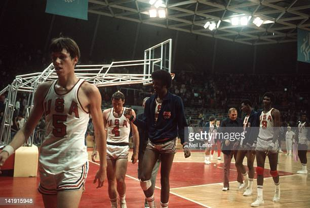 Summer Olympics: USA Kenneth Davis walking off court with Mike Bantom and Doug Collins after game vs Cuba during Preliminary Round at...