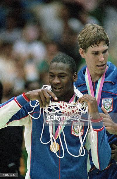 Basketball 1984 Summer Olympics Closeup of USA Michael Jordan victorious with net and gold medal after game vs ESP Los Angeles CA 8/10/1984
