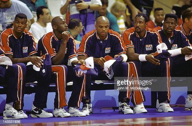 1992 Summer Olympics LR USA David Robinson Michael Jordan Charles Barkley Karl Malone and Patrick Ewing on sidelines before Men's Group A game vs...