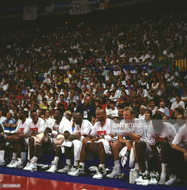 Summer Olympics: Team USA Scottie Pippen, Patrick Ewing, Michael Jordan, Charles Barkley, Larry Bird, and David Robinson on sidelines bench during...