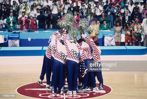 1992 Summer Olympics Team USA victorious with floral bouquets at center court after winning Men's Gold Medal Game vs Croatia at Pavello Olimpic Dream...