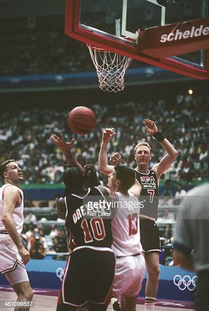 1992 Summer Olympics USA Larry Bird in action pass to Clyde Drexler vs Croatia Dino Radja during Men's Group A game at Pavello Olimpic Dream Team...