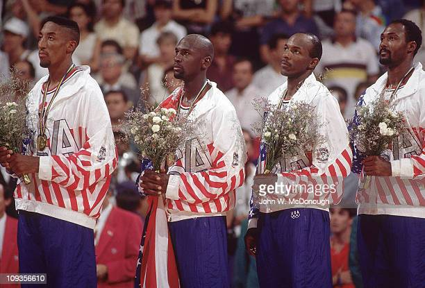 1992 Summer Olympics USA Scottie Pippen Michael Jordan Clyde Drexler and Karl Malone victorious on medal stand after winning Men's Gold Medal Game vs...