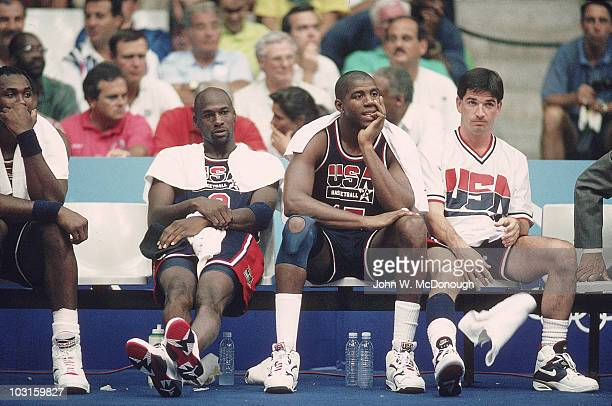 1992 Summer Olympics View of USA Karl Malone Michael Jordan Magic Johnson and John Stockton on sidelines bench during Men's Quarterfinals vs Puerto...