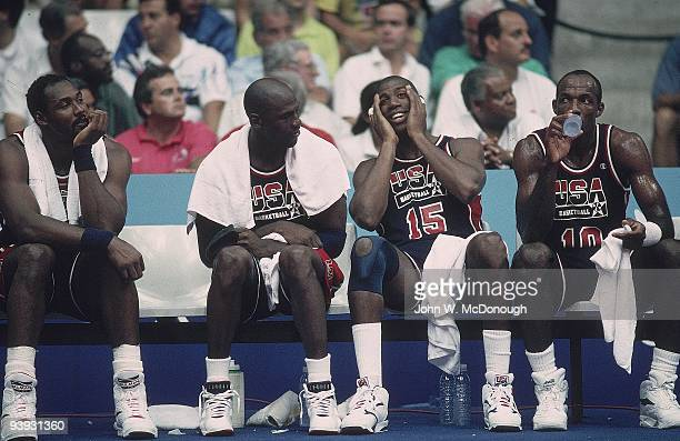 1992 Summer Olympics View of USA Karl Malone Michael Jordan Magic Johnson and Clyde Drexler during game vs Puerto Rico Dream Team Badalona Spain...