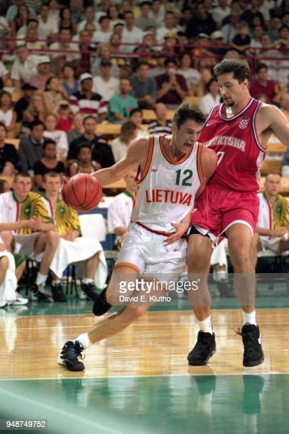 1996 Summer Olympics Croatia Toni Kukoc in action defense vs Lithuania Arturas Karnisovas during Men's Preliminary Round Group A game at Georgia Dome...