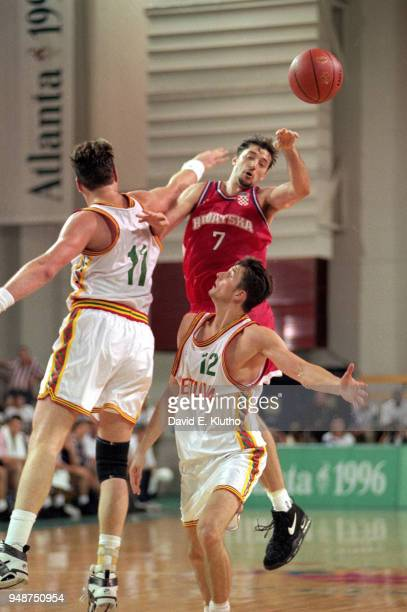 1996 Summer Olympics Croatia Toni Kukoc in action pass vs Lithuania Arturas Karnisovas and Arvydas Sabonis during Men's Preliminary Round Group A...