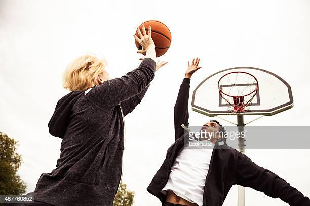Basketball 1v1 man-woman in a London playground