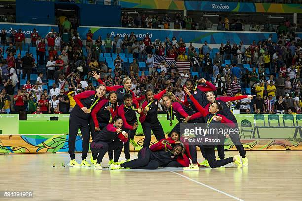 Summer Olympics: USA Basketball team posing with gold medals after defeating Spain in Women's Final - Gold Medal game at Carioca Arena 1. Rio de...