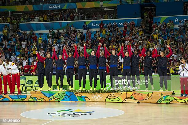 2016 Summer Olympics USA Basketball team victorious on the podium to get their gold medals after defeating Spain in Women's Final Gold Medal game at...
