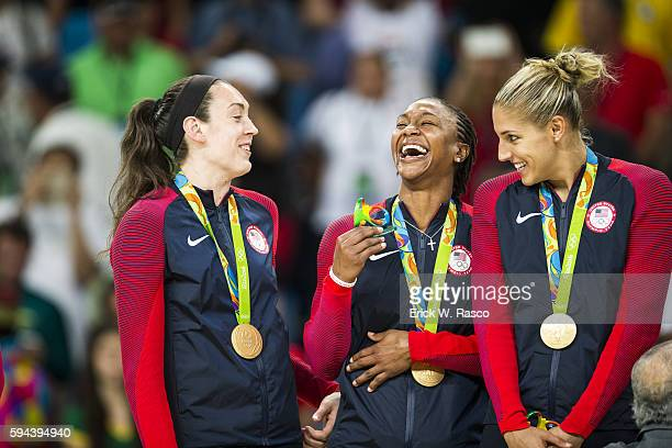2016 Summer Olympics USA Breanna Stewart Tamika Catchings and Elena Delle Donne victorious with gold medals on the podium after defeating Spain in...