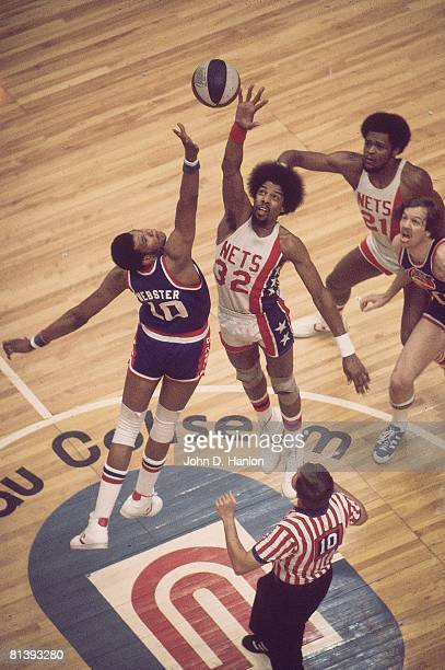 Basketball ABA Championship Aerial view of New York Nets Julius Dr J Erving in action jump ball vs Denver Nuggets Marvin Webster Uniondale NY 5/6/1976