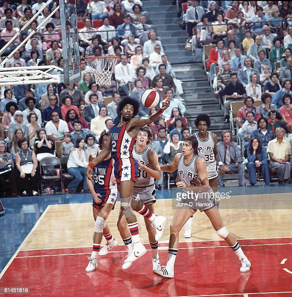 Basketball ABA Playoffs New York Nets Julius Dr J Erving in action vs San Antonio Spurs Allan Bristow Billy Paultz and Larry Kenon San Antonio TX...