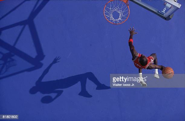 Basketball Aerial portrait of Chicago Bulls Michael Jordan in action making dunk Pontiac MI 3/5/1987