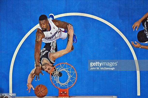Aerial view of Los Angeles Clippers DeAndre Jordan in action dunk over San Antonio Spurs Manu Ginobili at Staples Center Los Angeles CA CREDIT John W...