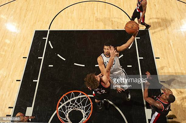 Aerial view of San Antonio Spurs Tim Duncan in action vs Portland Trail Blazers Robin Lopez at ATT Center San Antonio TX CREDIT Greg Nelson