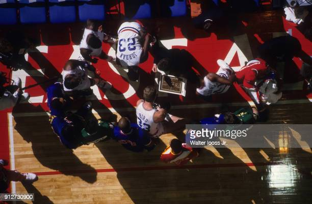 All Star Game Aerial view of Boston Celtics Larry Bird and Chicago Bulls Michael Jordan in sidelines huddle with teammates during game vs Team West...