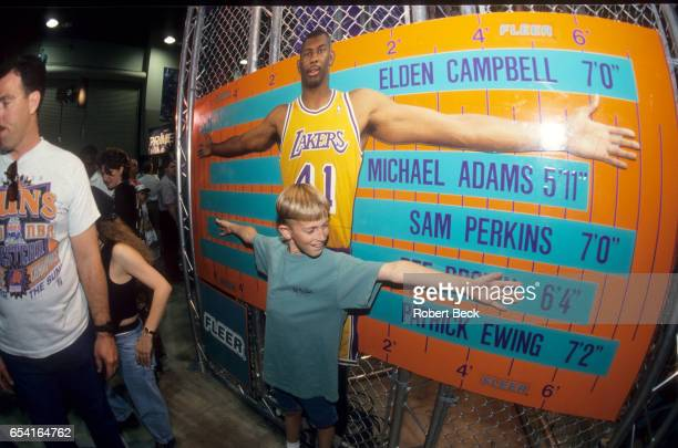 All Star Weekend View of young fan comparing his arm span to NBA stars on chart at America West Arena Phoenix AZ CREDIT Robert Beck