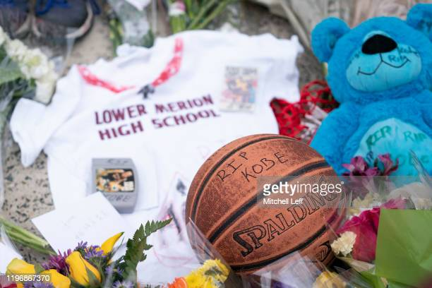 A basketball along with a tshirt and a teddy bear are left at a memorial for former Los Angeles Laker Kobe Bryant after he was killed in a helicopter...