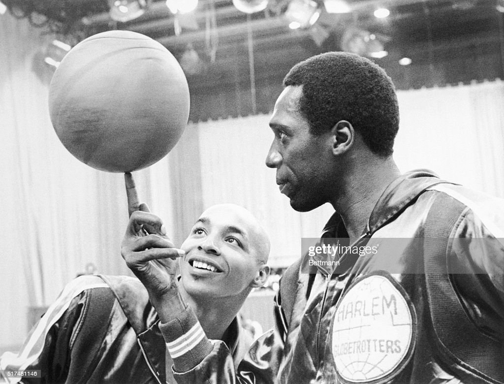 Basketball, Anyone? Fred 'Curly' Neal (left) admires Meadowlark Lemon's adroit ball-handling in the CBS Sports special, Harlem Globetrotters: The Road to Mexico, to be broadcast in color Saturday, January 24 (7:30-8:30 p.m., EST) on the CBS Television Network. March 1968.