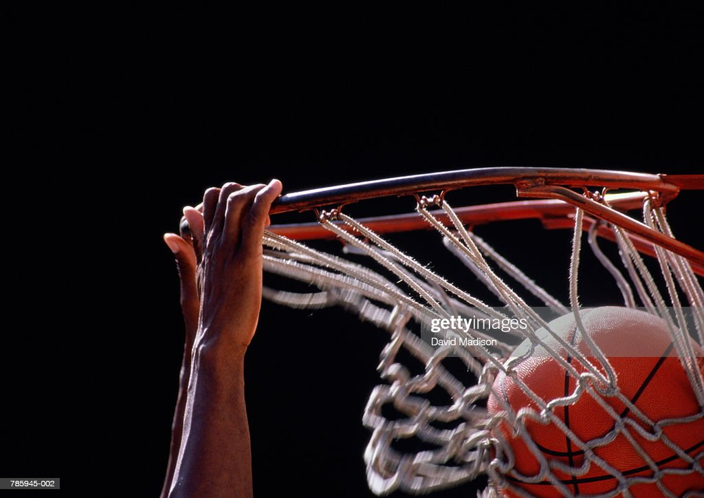 Basketball, ball being dunked through basket, close up : Stock Photo