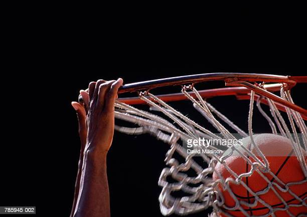 Basketball, ball being dunked through basket, close up