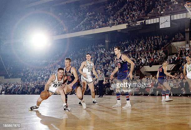 Boston Celtics Bill Sharman in action vs Fort Wayne Pistons Chuck Noble and Mel Hutchins at Boston Garden Boston MA CREDIT Hy Peskin