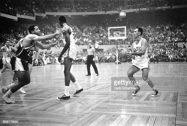Boston Celtics Bob Cousy in action taking shot behind pick by teammate Bill Russell during game vs Cincinnati Royals Boston MA 11/5/1960 CREDIT Herb...