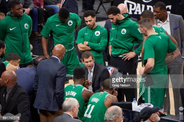 Boston Celtics coach Brad Stevens in huddle with players during timeout during game vs San Antonio Spurs at ATT Center San Antonio TX CREDIT Greg...