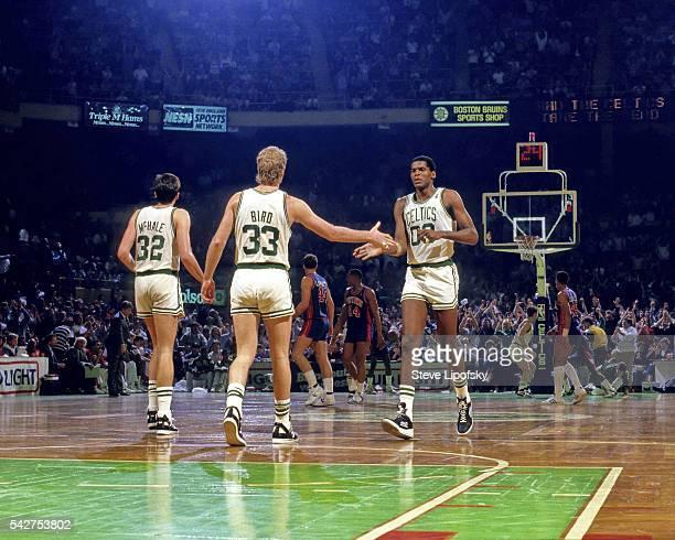 Boston Celtics Kevin McHale Larry Bird and Robert Parish during game vs Detroit Pistons at Boston Garden Boston MA CREDIT Steve Lipofsky