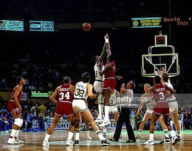 Boston Celtics Robert Parish in action tipoff vs Philadelphia 76ers Moses Malone at Boston Garden Boston MA CREDIT Steve Lipofsky