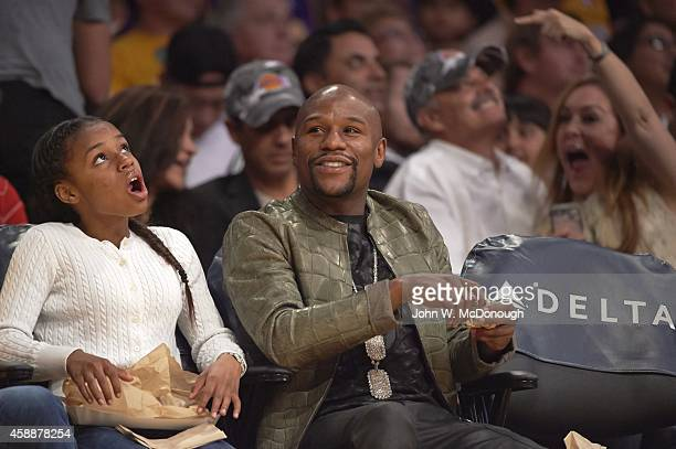 Boxer Floyd Mayweather Jr with daughter Iyanna sitting courtside during Los Angeles Lakers vs Charlotte Hornets game at Staples Center Los Angeles CA...