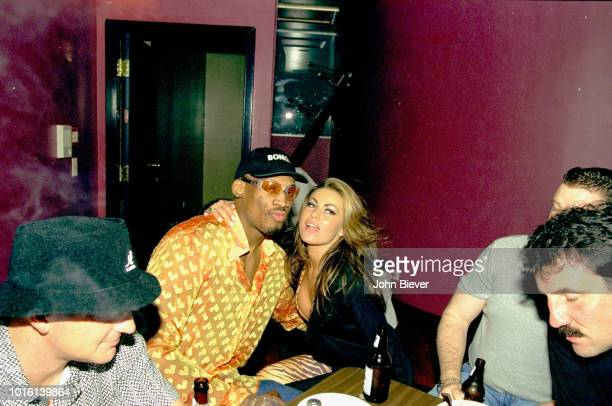 Casual portrait of Chicago Bulls Dennis Rodman with Carmen Electra at his birthday party Chicago IL CREDIT John Biever
